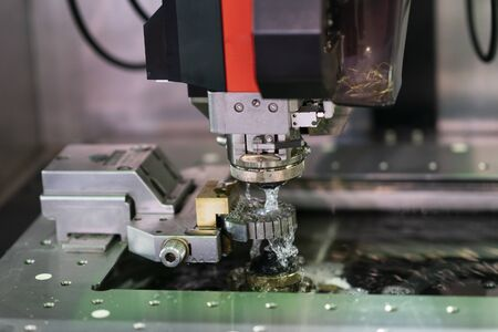 CNC wire cut machine cutting high precision mold parts, cutting metal by electric discharge, high technology wirecut machine for precision manufacturing 写真素材