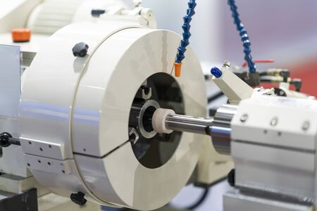 operator make automotive parts by cnc lathe and cnc grinding process 写真素材