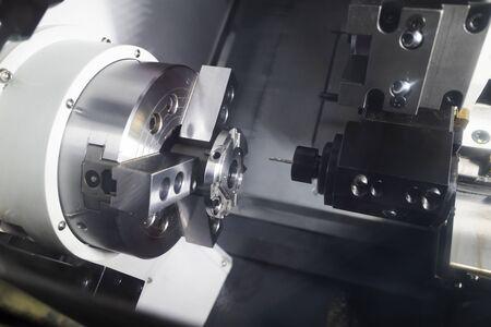 Operator machining automotive part by cnc turning machine 写真素材