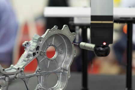 operator inspection high precision part by CMM coordinate measuring machine, CMM for inspection and reverse engineering by cnc programing control, high accuracy part verification 写真素材