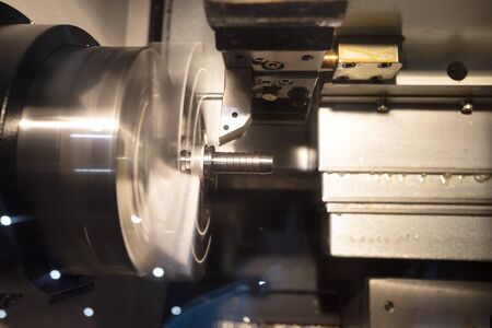 Operator machining automotive part by cnc turning machine, high accuracy with multi axis, multi spildle cnc turning and milling machine