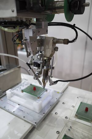 robot arm for automatic production line, high tech manufacturing process, high precision robotic arm for accuracy work 写真素材