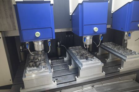machining precision part by CNC machining center, mold, die and high accuracy part for automotive industrial Archivio Fotografico