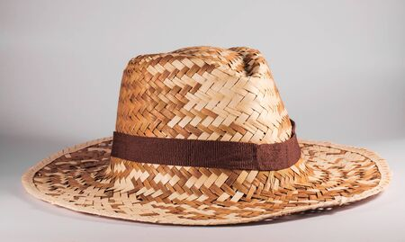 Wood woven hat with a white background photo