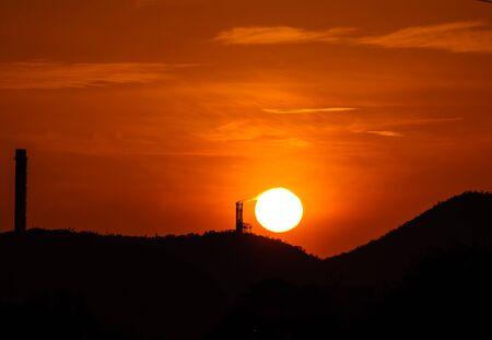 The burning sun of the chimney photo
