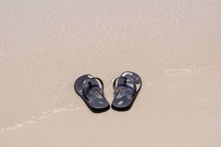 sandles: Beach sandals on a sandy beach with background