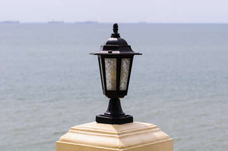 A light poles along on the beach. photo