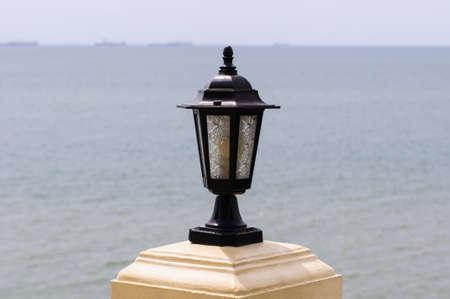A light poles along on the beach. photo