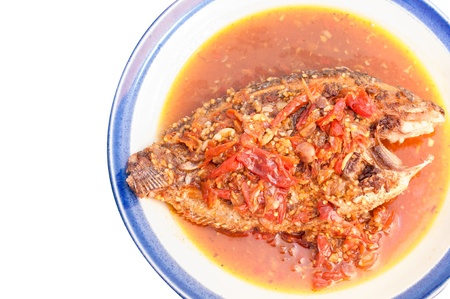 chili's restaurant: A deep fried fish topped with chili  Stock Photo