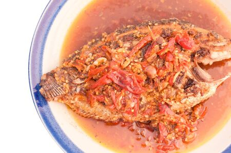 chili's restaurant: A deep fried fish topped with chili.