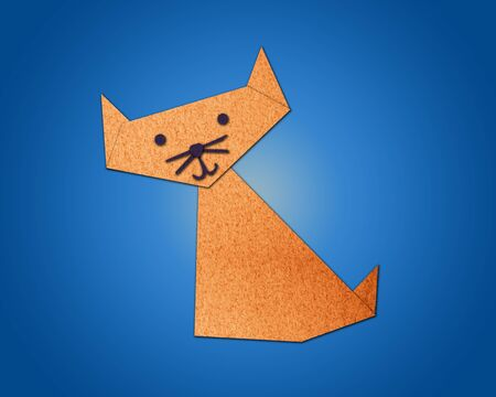 Origami cat made from paper on blue background photo