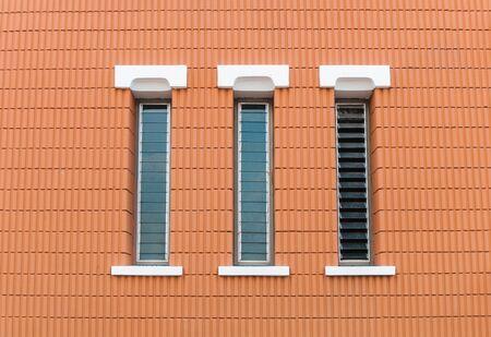 three window in a brick wall building photo