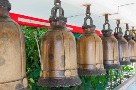 Bells in a Buddhist temple of Thailand photo