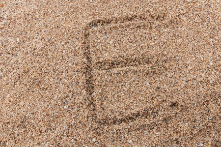 Character E of the alphabet writing on the sand Stock Photo - 17754170