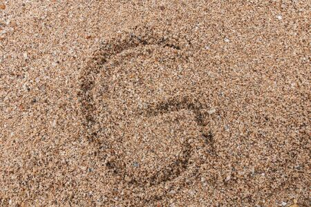 Character G of the alphabet writing on the sand Stock Photo - 17754195