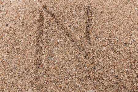 Character N of the alphabet writing on the sand Stock Photo - 17754193