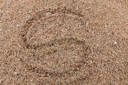 Character S of the alphabet writing on the sand Stock Photo - 17754186