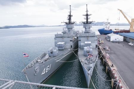 a battleship: Battleship docked at the harbor. Bow with anchor