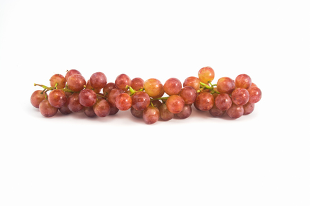fascicle: Red grapes fresh with water drops on white background