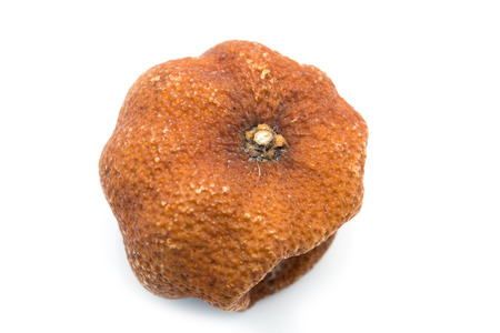 Rotten orange isolated on a white