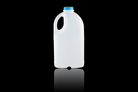 A Gallon Milk isolate on the black  photo