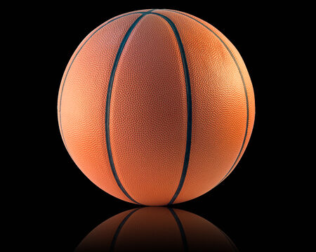 basketball ball: A Basketball isolated on the black background Stock Photo