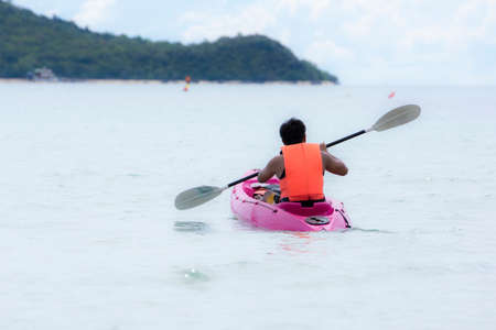 Sea kayak in thai ocean sai kaew beach photo