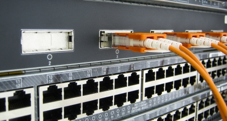 rj45: GBIC optic fiber communications equipment installed in a large datacenter. Stock Photo