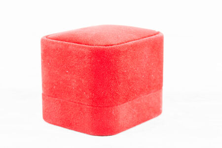 Red jewelry box to putting ring on white background photo