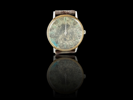 Old watch with leather on black background photo