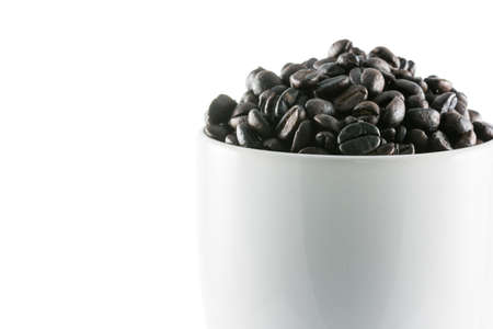 overflow: coffee beans overflow cup isolate on white background