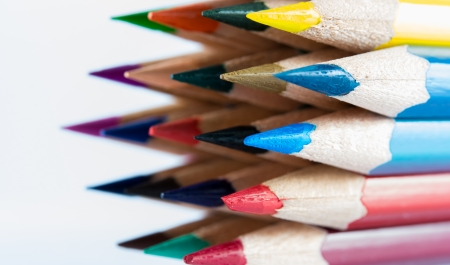 pointed color pencils and a white  photo