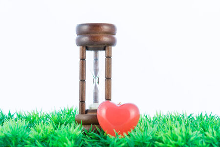 Red hearts and hourglass isolated on white background background photo