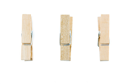 Wooden clothespin isolate on a white background