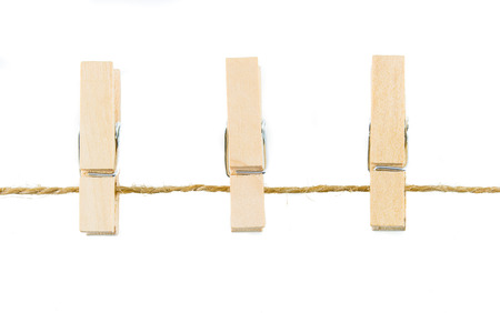 clothespins on rope isolate on white background Stockfoto