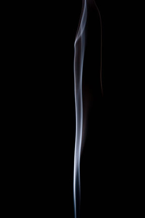 magical background: Abstract incense smoke isolated on black background