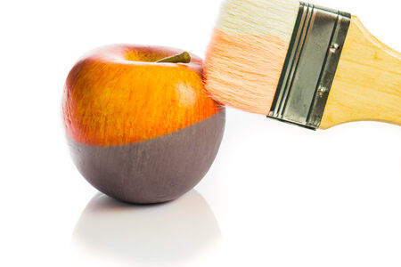 painting a fresh red apple black and white isolated on white background Standard-Bild