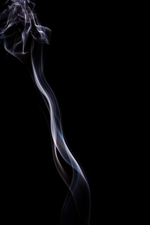 Abstract incense smoke isolated on black background