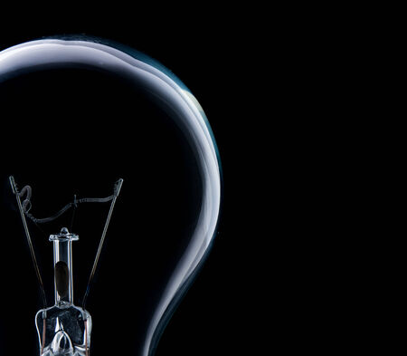 electricity background: Lamp light bulb isolated on over black background Stock Photo