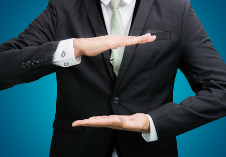 Businessman standing posture show hand isolated on over blue background photo