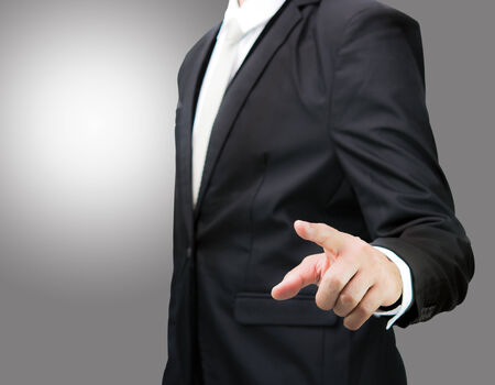 Businessman standing posture show hand isolated on over gray background photo