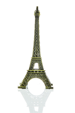 Small Eiffel tower isolated on over white background photo