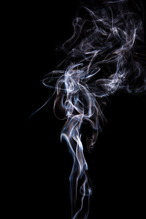 Abstract incense smoke isolated on black background photo