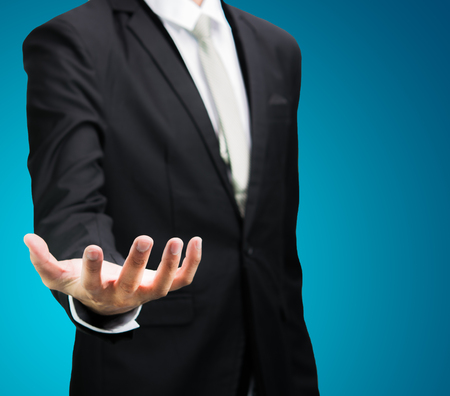 businessman standing: Businessman standing posture show hand isolated on over blue background Stock Photo