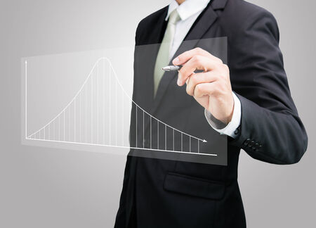 Businessman hand drawing a graph Isolated on gray background