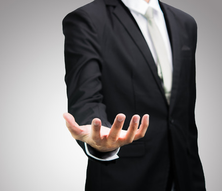 De zakenman toont de hand geïsoleerd staande houding Stockfoto - 28685330