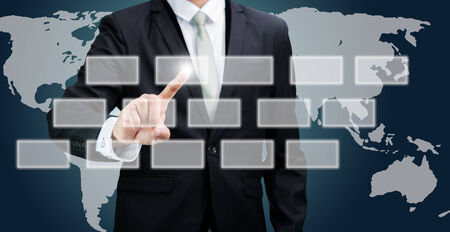 Businessman standing posture hand touching technology concept on dark background photo