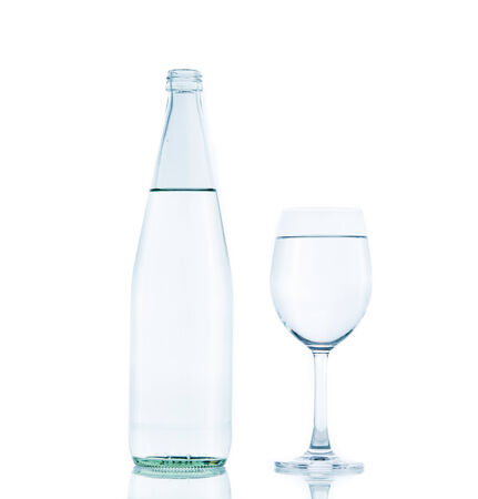 Bottle and Glass water clear isolate on over white background photo