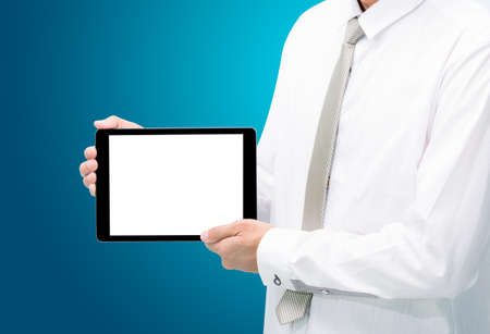 Businessman standing posture hand holding blank tablet isolated on blue background photo