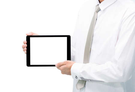 Businessman standing posture hand holding blank tablet isolated on over white background photo